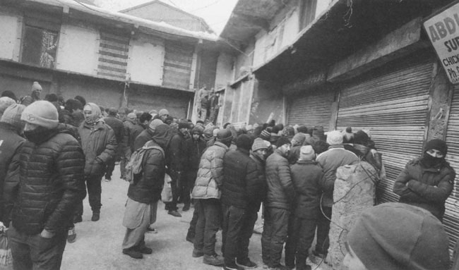 Chaos outside a cooperative shop selling vegetables in Kargil, Ladakh